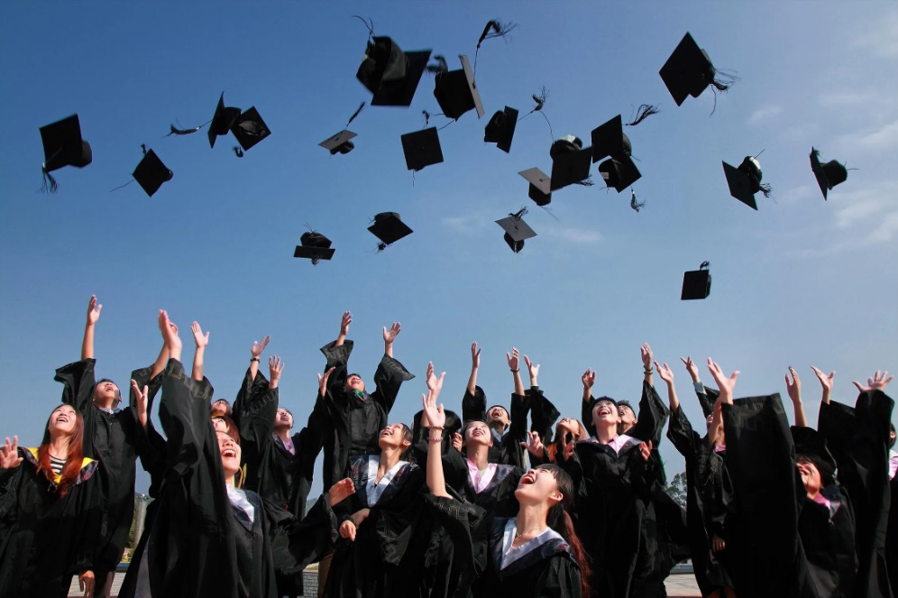 GRADUATE STUDENT throwing their hats in the air