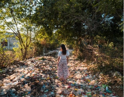 a girl standing on waste disposal